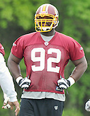 Ashburn, VA - May 2, 2009 -- Defensive tackle Albert Haynesworth (92) watches as his teammates participate in the 2009 Washington Redskins mini-camp at Redskins Park in Ashburn Virginia on Saturday, May 2, 2008..Credit: Ron Sachs / CNP
