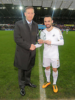 (L-R) Swansea chairman Huw Jenkins gives Leon Britton an award before the Barclays Premier League match between Swansea City and Crystal Palace at the Liberty Stadium, Swansea on February 06 2016