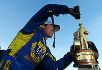 Oct. 28, 2012; Las Vegas, NV, USA: NHRA funny car driver Ron Capps celebrates after winning the Big O Tires Nationals at The Strip in Las Vegas. Mandatory Credit: Mark J. Rebilas-