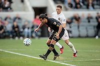 LOS ANGELES, CA - MARCH 01: Carlos Vela #10 of LAFC takes a chip shot and scores a goal during a game between Inter Miami CF and Los Angeles FC at Banc of California Stadium on March 01, 2020 in Los Angeles, California.