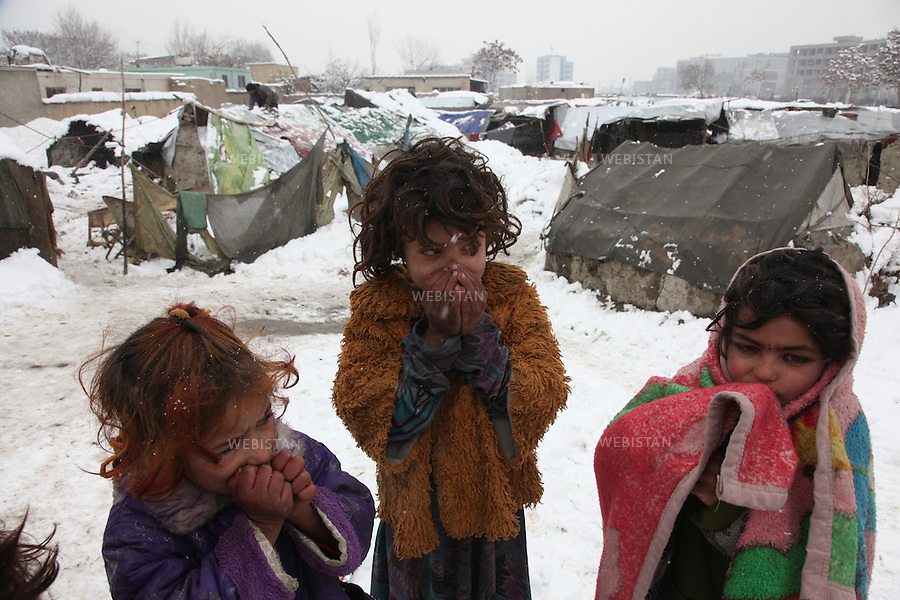 AFGHANISTAN. KABUL. FEBRUARY 2012: Winter makes the lives of these internally displaced people (IDPs) even worse. The makeshift camp in Chamn-e-Babrak area of Kabul. This makeshift is the home to tens of IDPs who live harsh conditions particularly in winter......