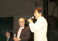 Actor &amp; film maker Jackie Chan (R)  get on stage with World Film Festival's President  Serge Losique (L) for the free outdoor  projection of one of Chan's movie `. at the 25th World Film Festival,Sept 1st 2001 in Montreal, CANADA.<br /> <br /> Apprenticed to the Peking Opera by his parents at the age of 6, Jackie Chan was rigorously trained in music, dance, and traditional martial arts. A visiting filmmaker offered Chan his first (tiny) role as a stunt player. Chan took the part, and soon left the Opera to pursue the world of film. Fellow Opera students Biao Yuen and Sammo Hung Kam-Bo would also have careers in film, and the three would star in several films together in the following years. Chan's talent and enthusiasm soon saw him taking larger and more important roles, graduating first to stunt coordinator, and then to director. <br /> <br /> <br /> <br /> Following the death of martial arts legend Bruce Lee, the search was on for an actor who could inspire audiences to the same degree; every young martial artist was given a chance. Chan decided that rather than emulating Lee (and thus living forever in his shadow), he would develop his own style of filmmaking. His directorial debut Shi di chu ma (1980) was a milestone in martial arts films, being the first to effectively combine comedy with action. This set the tone for many of his future films, which combined slapstick humor with high-energy martial arts action. A self-confessed fan of Buster Keaton and Harold Lloyd, Chan performs all his own stunts, quite often at his own peril. His later films include outtakes of his on-set injuries run under the closing credits. He is the world number one in his field