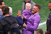 3rd February 2019, Atlanta Georgia, USA; NFL Superbowl LIII, New England Patriots versus Los Angeles Rams; Conor McGregor and his son Conor Jack McGregor Jr. talk with New England Patriots owner Bob Kraft prior to Super Bowl LIII