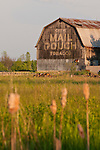 "Old weathered wooden barn with ""Chew Mail Pouch Tobacco"" painted on the end, rural Mich."