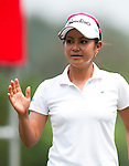 CHON BURI, THAILAND - FEBRUARY 17:  Ai Miyazato of Japan waves after a putt on the 5th hole during day two of the LPGA Thailand at Siam Country Club on February 17, 2012 in Chon Buri, Thailand.  Photo by Victor Fraile / The Power of Sport Images