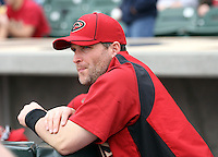 Russell Branyan #75 of the Arizona Diamondbacks watches from the sidelines during a game against the Colorado Rockies in the inaugural spring training game at Salt River Fields on February 26, 2011 in Scottsdale, Arizona. .Photo by:  Bill Mitchell/Four Seam Images.