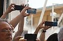 Smartphone focused on cheerleaders of Trojan's parade at Expo 2015, Rho-Pero, Milan, July 4, 2015.<br /> <br /> Smartphone puntati sulle cheerleader della parata Trojan's a Expo 2015, Rho-Pero, Milano, 4 luglio 2015.