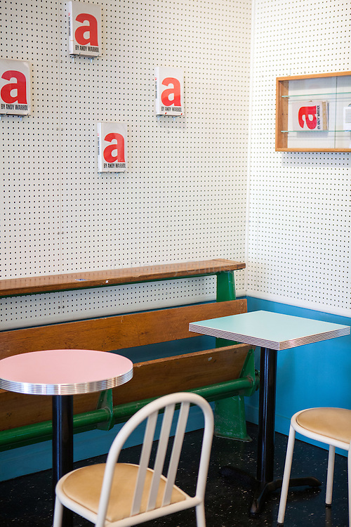 André Saraiva's new Cafe Henri in Chinatown. On the wall are copies of an Andy Warhol book. In the case, a handbag by Olympia Le-Tan modeled after the same book. <br /> <br /> Danny Ghitis for The New York Times