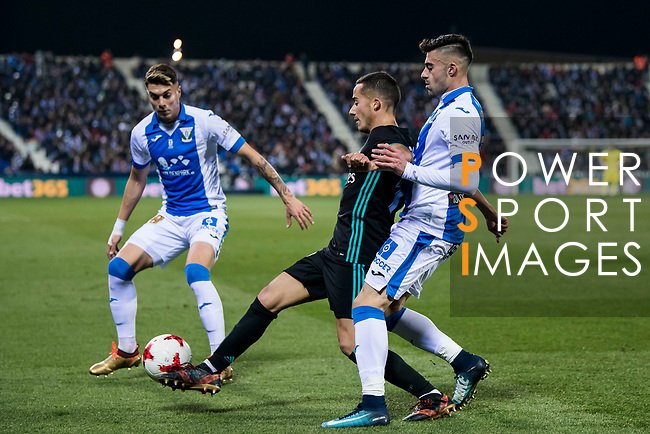 Lucas Vazquez of Real Madrid battles for the ball with Diego Rico Salguero of CD Leganes during the Copa del Rey 2017-18 match between CD Leganes and Real Madrid at Estadio Municipal Butarque on 18 January 2018 in Leganes, Spain. Photo by Diego Gonzalez / Power Sport Images