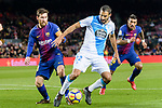 Lionel Messi of FC Barcelona (L) in action against Celso Borges Mora of RC Deportivo La Coruna (C) during the La Liga 2017-18 match between FC Barcelona and Deportivo La Coruna at Camp Nou Stadium on 17 December 2017 in Barcelona, Spain. Photo by Vicens Gimenez / Power Sport Images