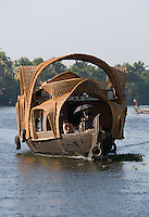 January 28th, 2008_Kerala State, India_ Luxury houseboats cruise through the backwaters of the Southern Indian state of Kerala.  The waterways are a signature attraction in Kerala and are also an important link for communities and commerce there.  Photographer: Daniel J. Groshong/Tayo Photo Group