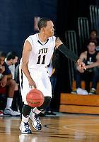 Florida International University guard Phil Taylor (11) plays against Florida Atlantic University, which won the game 66-64 on January 21, 2012 at Miami, Florida. .