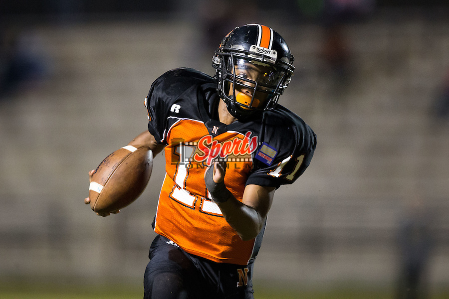 IJ Sturdiant (11) of the Northwest Cabarrus Trojans runs with the football during first half action against the Concord Spiders at Trojan Stadium October 29, 2015, in Concord, North Carolina.  The Spiders defeated the Trojans 30-26.  (Brian Westerholt/Sports On Film)