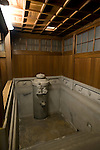 Photo shows the private bath inside the Yushinden, a room built in 1899 for the Imperial family, at Dogo Onsen, thought to be Japan's oldest spa in Matsuyama City, Ehime Prefecture, Japan on 20 Feb. 2013.  Chiseled into the cylindrical Aji stone tank that feeds the bath, a benevolent-looking deity named Okuninushi-no-mikoto bathes a sick Sukunahiko-no-mikoto in Dogen's waters. According to tradition, the latter makes a miraculous recovery, performing a dance on a rock to prove it.Photographer: Robert Gilhooly