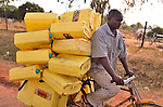 In northern Uganda, plastic water containers are vital.  With improving roads, bicycles loaded with goods are common.
