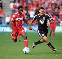 Chicago Fire forward Patrick Nyarko (14) dribbles away from DC United defender Jed Zayner (12).  The Chicago Fire tied DC United 0-0 at Toyota Park in Bridgeview, IL on Oct. 16, 2010.