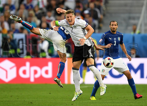 02.07.2016. Bordeaux, France.  Germany's Bastian Schweinsteiger and Italy's Emanuele Giaccherini during the UEFA EURO 2016 quarter final  match between Germany and Italy at the Stade de Bordeaux in Bordeaux, France, 02 July 2016.