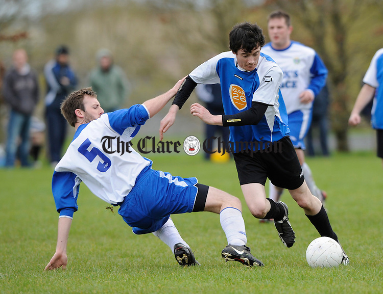 Kilkishen's Matt Holmes in action against Hermitage's Darren Lynch during their Clare League Division 3 game at the Fair Green. Photograph by John Kelly.