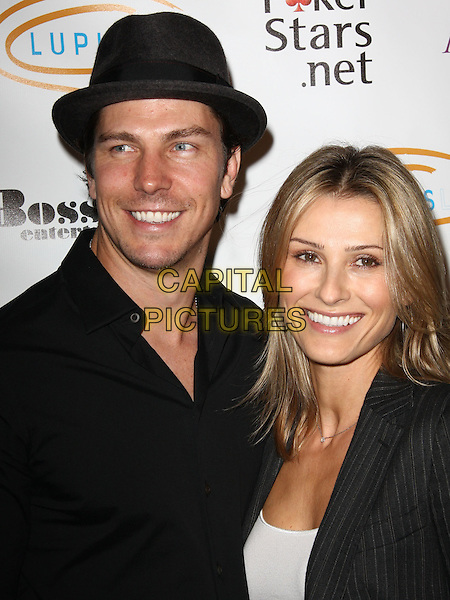 "MICHAEL TRUCCO & SANDRA HESS. Lupus LA Raises Awareness with ""Get Lucky for Lupus"" held At Andaz Hotel, West Hollywood, California, USA..February 25th, 2010.headshot portrait black hat.CAP/ADM/KB.©Kevan Brooks/AdMedia/Capital Pictures."