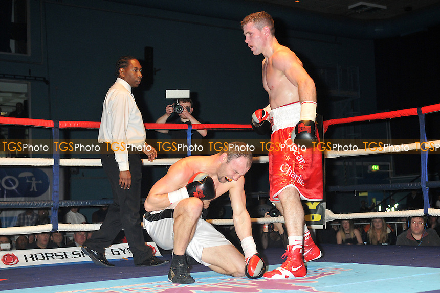 Eamonn O'Kane (red shorts) defeats Ferenc Hafner - Boxing at the Oasis Leisure Centre, Swindon, Wiltshire - 14/02/15 - MANDATORY CREDIT: Philip Sharkey/TGSPHOTO - Self billing applies where appropriate - contact@tgsphoto.co.uk - NO UNPAID USE