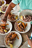 BELIZE, Punta Gorda, Village of San Pedro Colombia, lunch being made at the home of Eladio Pop, rice, beans, chicken and root vegetables