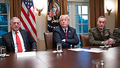 United States President Donald J. Trump, center, makes a statement to the media as he prepares to receive a briefing from senior military leaders in the Cabinet Room of the White House in Washington, DC on Tuesday, October 23, 2018.  The President took questions on the proposed space force, immigration, the caravan and Saudi actions in the killing of Jamal Khashoggi.  At left is US Secretary of Defense James Mattis and at right is US Marine Corps General Joseph F. Dunford, Chairman of the Joint Chiefs of Staff.<br /> Credit: Ron Sachs / Pool via CNP