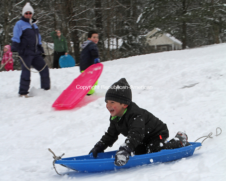 Torrington, CT-24 January 012415MK04 Carl West races downhill as dozens of  children enjoyed sliding on the fresh four inches of snow at Major Besse Park in Torrington Saturday afternoon. Michael Kabelka / Republican-American