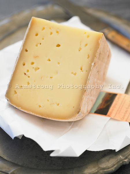 A large wedge of artisanal cheese