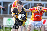 Kieran O'Leary, Dr. Crokes in action against Barry Moran, in the All Ireland Senior Club Semi Final at Portlaoise on Saturday.