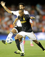 Valencia's Daniel Parejo (l) and AS Monaco FC's Fabinho during Champions League 2015/2016 Play-Offs 1st leg match. August  19,2015. (ALTERPHOTOS/Acero)