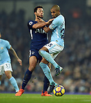 Fernandinho of Manchester City is challenged by Mousa Dembele of Tottenham Hotspur during the premier league match at the Etihad Stadium, Manchester. Picture date 16th December 2017. Picture credit should read: Robin ParkerSportimage