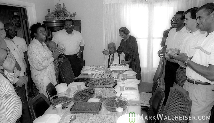 Legendary FAMU football coach Alonzo Smith (Jake) Gaither and his wife Sadie receive a standing ovation at his home in Tallahassee on his 88th birthday April 11, 1991.  Gaither compiled a 203-36-4 record, a .844 winning percentage  from 1945 till 1969.  Gaither died two years later at 90.