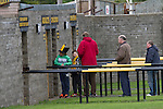 Berwick Rangers 5 East Stirlingshire 0, 23/08/2014. Shielfield Park, Scottish League Two. Home supporters queueing to gain admission to Shielfield Park, before the Scottish League Two fixture between Berwick Rangers and East Stirlingshire. The home club occupied a unique position in Scottish football as they are based in Berwick-upon-Tweed, which lies a few miles inside England. Berwick won the match by 5-0, watched by a crowd of 509. Photo by Colin McPherson.