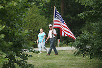 A man waves an American flag patriotically in Charlottesville, VA