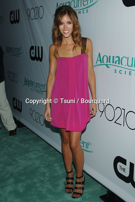Kayla Ewell - <br /> 90210 Premiere Party in a Private house in Malibu<br /> <br /> full length<br /> eye contact<br /> smile