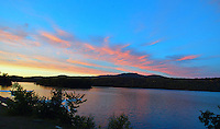 A sunset over mountains and a lake near Mont-Tremblant, Quebec, Canada(Photo by Brian Cleary/www.bcpix.com)