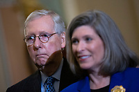 United States Senate Majority Leader Mitch McConnell (Republican of Kentucky) and United States Senator Joni Ernst (Republican of Iowa) listen during a news conference following Republican policy luncheons at the United States Capitol in Washington D.C., U.S. on Tuesday, February 11, 2020.  <br /> <br /> Credit: Stefani Reynolds / CNP/AdMedia