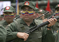 "Reservistas venezolanos marchan en el desfile del Dia de la independencia.La Reserva militar de la Fuerza armada nacional.Cada soldado reservista es el pueblo con las armas al pecho para defender la soberana Patria venezolana,segun palabras del presidente Chavez./Venezuelan Reserve soldiers march during Independence day military parade.""Every one soldier of reserve,is the people armed to defend sovereignty of homeland"",said President Hugo Chavez..Photo by Carlos Hernandez/Caribe Focus"