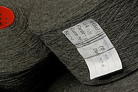 Bobbins of grey woollen thread