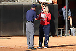 RALEIGH, NC - MARCH 29: Liberty head coach Dot Richardson (right) talks to first base umpire Alex Leap (left). The North Carolina State University Wolfpack hosted the Liberty University Flames on March 29, 2017, at Dail Softball Stadium in Raleigh, NC in a Division I College Softball game. Liberty won the game 5-3.