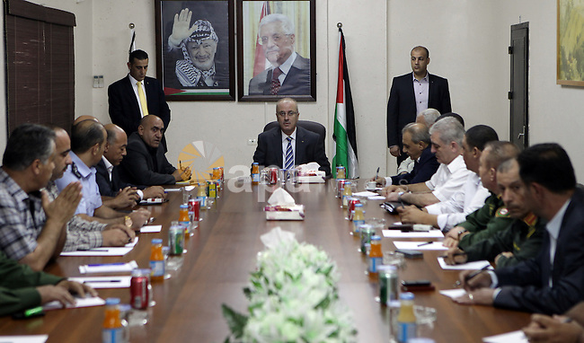 Palestinian Prime Minister Rami Hamdallah chairs a meeting with security chiefs, in the West Bank city of Nablus on Sep. 4, 2015. Photo by Prime Minister Office