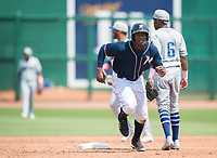 NWA Democrat-Gazette/CHARLIE KAIJO Northwest Arkansas Naturals right fielder Elier Hernandez (21) sprints to third during a baseball game, Sunday, May 13, 2018 at Arvest Ballpark in Springdale.