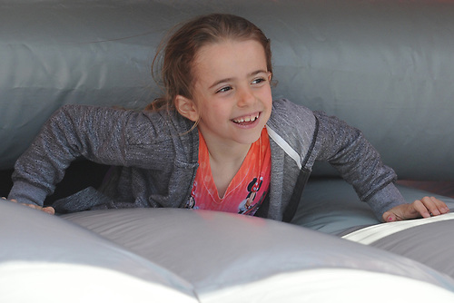 Mia DelVecchio, 6, of Massapequa Park has fun on an inflatable obstacle course during Long Island Marathon Weekend festivities at Eisenhower Park on Saturday, May 5, 2018.