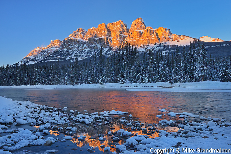 Castle Mountain reflected in the Bow River. at sunset. Castle Junction, Banff National Park, Alberta, Canada