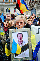 Protester with a picture of his nephew killed in combat against the Russians.<br /> National demonstration of the Ukrainian community in Italy for recurrence of the second year of the aggression of Russia in Ukraine and against the illegal annexation of Crimea to the Russian Federation. Rome Italy. 28th Febraury 2016