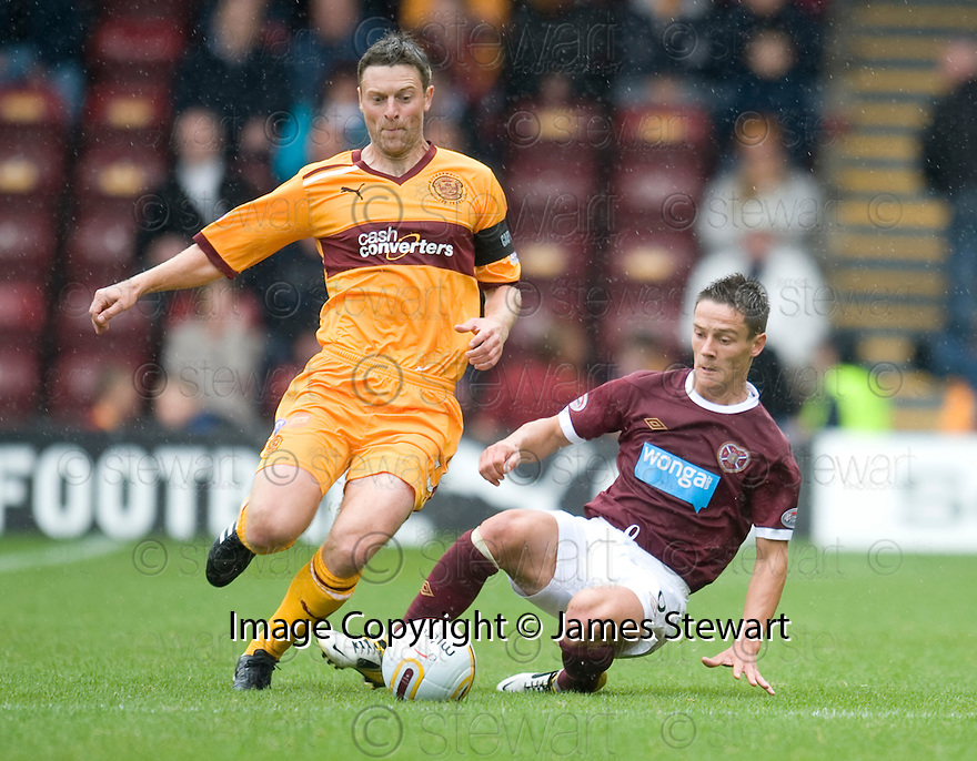 MOTHERWELL'S STEPHEN CRAIGAN GETS AWAY FROM HEARTS' IAN BLACK