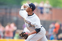 Charleston RiverDogs relief pitcher Angel Rincon (13) delivers a pitch to the plate against the Hickory Crawdads at L.P. Frans Stadium on May 25, 2014 in Hickory, North Carolina.  The RiverDogs defeated the Crawdads 17-10.  (Brian Westerholt/Four Seam Images)