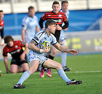 Hendon, England. Gavin Evans (c) of Cardiff Blues  in actions during the LV= Cup match for the first professional rugby game on the artificial turf pitch made for rugby between Saracens and Cardiff Blues at Allianz Park Stadium on January 27, 2013 in Hendon, England.
