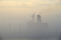 Ship barely visible in fog