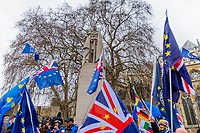 LONDON, ENGLAND - JANUARY 15: Statue of George V with flags pro NO Brexit on January 15, 2019 in London, England. Theresa May's Brexit deal finally reaches the House of Commons this evening and MPs will begin voting on it at 7pm. The Prime Minister has consistently said her's is the only deal that Brussels will entertain and urged support from Parliament to avoid the UK crashing out of the European Union with no deal. Photo Adamo Di Loreto